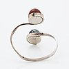 Sterling silver with cabochon-sut stone bangle.