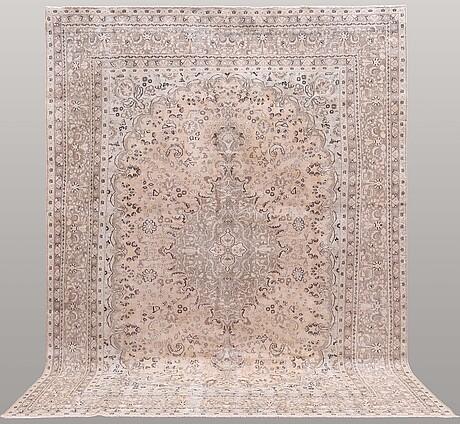 A carpet, oriental, ca 400 x 290 cm.