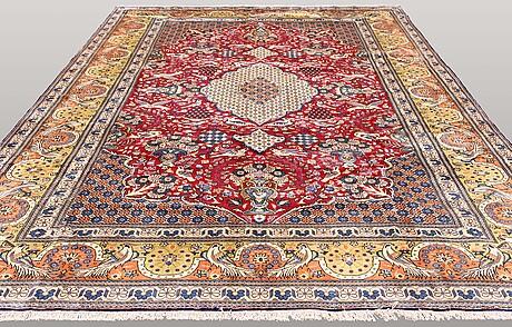 A carpet, figural qum, 400 x 294 cm.