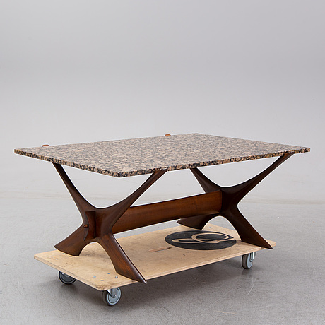 A 1960/70's coffee table by fredrik schriever-abeln with a stone top-.