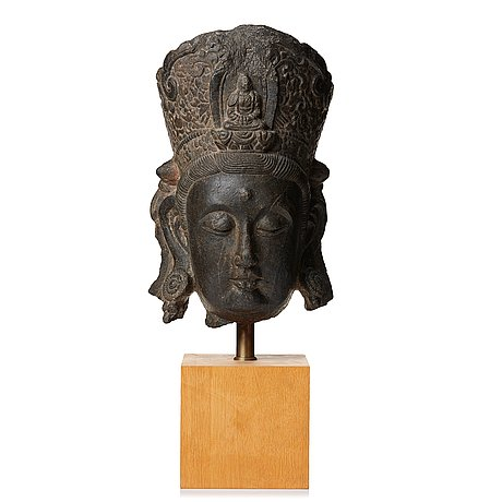 A large sculptured stone head of guanyin, ming dynasty (1368-1644).
