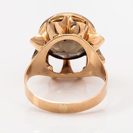 A 14k gold ring with a smoky quartz. liitola & koistinen kultasepät, turku 1976.