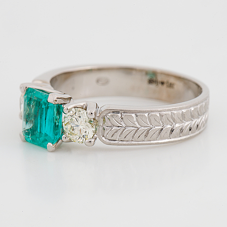 Emerald and brilliant-cut diamond ring.