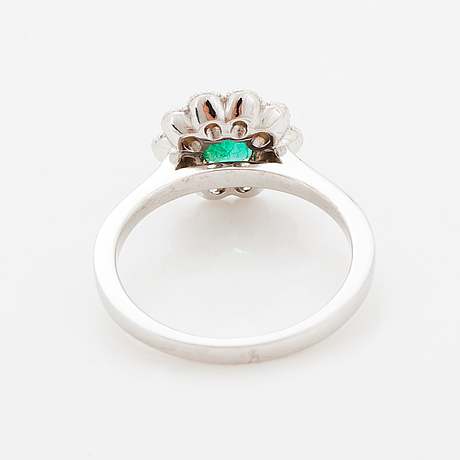 Emerald and brilliant-cut diamond cluster ring.