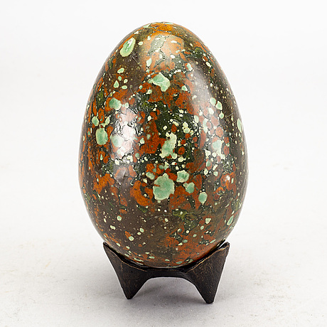 A faience sculpture of an egg, by hans hedberg, biot, france.