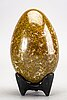 A faience sculpture of an egg by hans hedberg, biot, france.