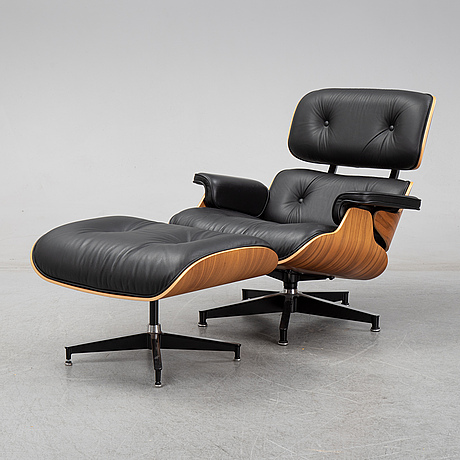 Charles and ray eames, a walnut 'lounge chair' and ottoman, heman miller, 2016.