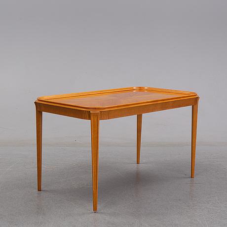 An elm swedish modern coffee table, dated 11 11 1947.