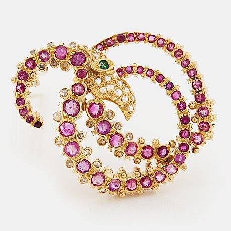 An ilias lalaounis brooch in 18k gold set with faceted rubies, an emerald and rose-cut diamonds.