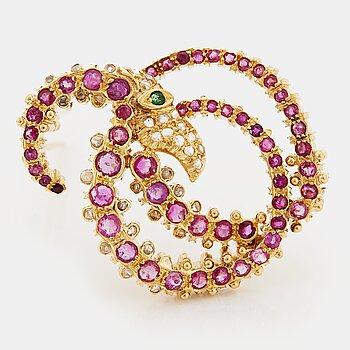 Ilias Lalaounis brosch 18K guld med fasettslipade rubiner, en smaragd och rosenslipade diamanter.