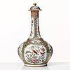 A canton famille rose vase with cover, qing dynasty, late 19th century.