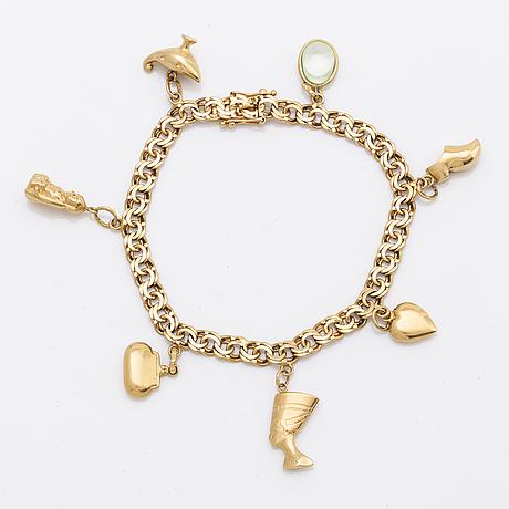 T ahlberg & co armband med berlocker 18k guld stockhlom 1973, total vikt 16 gram.