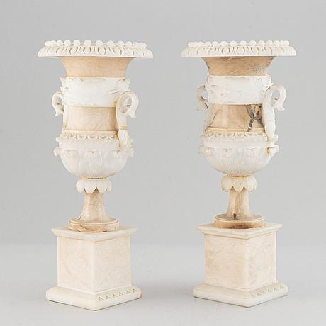 A pair of 20th century alabaster vases.