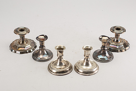A set of three pair of swedish 20th century silver candle sticks.