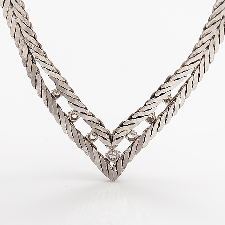 An 18k white gold necklace with diamonds ca. 0.33 ct in total. import marked kellomiehet, helsinki 1967.