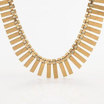 A 14K gold necklace. Import marked Koruteollisuus Tillander, Helsinki 1965.
