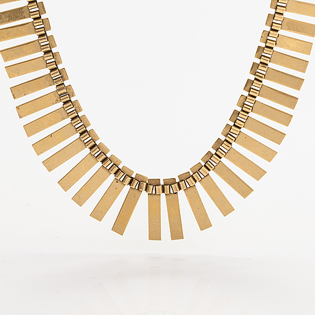 A 14k gold necklace. import marked koruteollisuus tillander, helsinki 1965.
