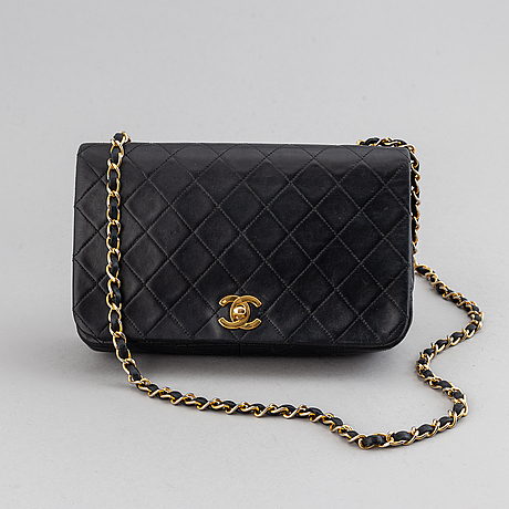 Chanel, a quilted leather 'flap' bag, 1989-91.