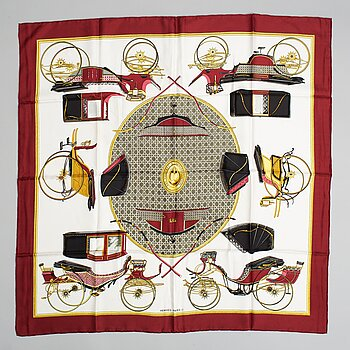 Hermès, a 'Les Voitures a Transformation' silk scarf.