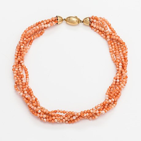 A 6-strand pearl collier with coral pearls and an 18k gold clasp.