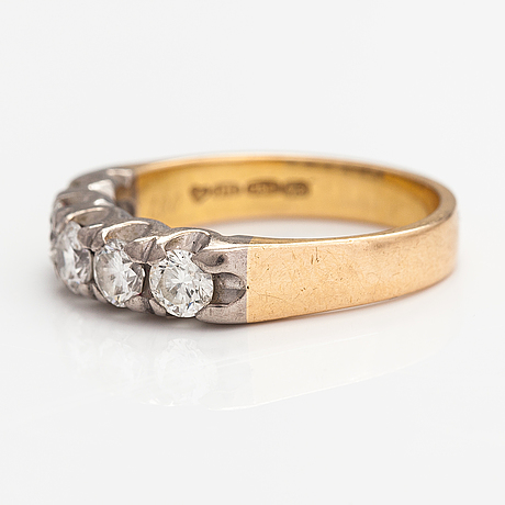 An 18k gold ring with diamonds ca. 1.00 ct in total. finland 1998.