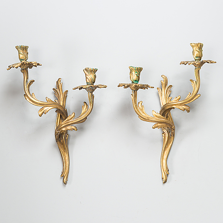 A pair of rococostyle wall sconces from the beginning of the 20th century.