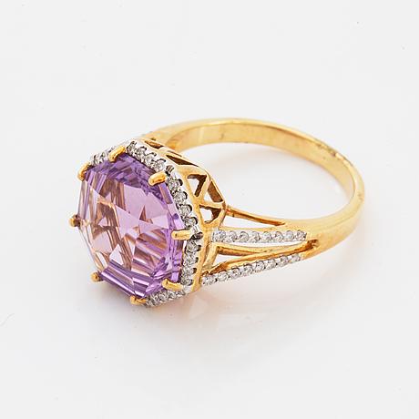 An amethyst ring.
