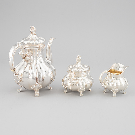 A 20th century silver coffee pot, creamer and sugar bowl. swedish import mark.