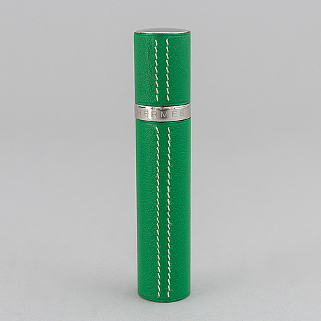 Hermès, refillable perfume bottle in leather.