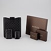 Gucci, ipad-case, key-case and mobile-case.