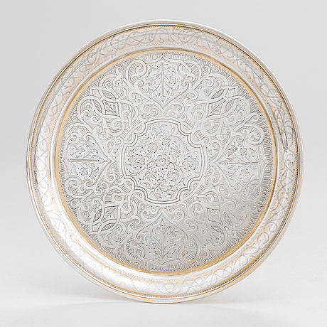 A parcel-gilt silver tray, moscow 1856.