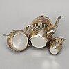 A silver coffee pot, creamer and sugar bowl, mark of carl august björklund, stockholm 1900.