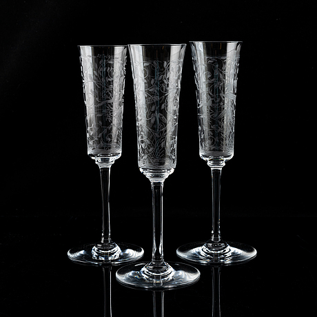 A set of 18 champagne flutes, engraved with animals and leafwork, 20th century europe .