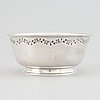 Tore eldh, a silver bowl, decorated with a border of leafy sprigs, gothengurg, sweden, 1950.