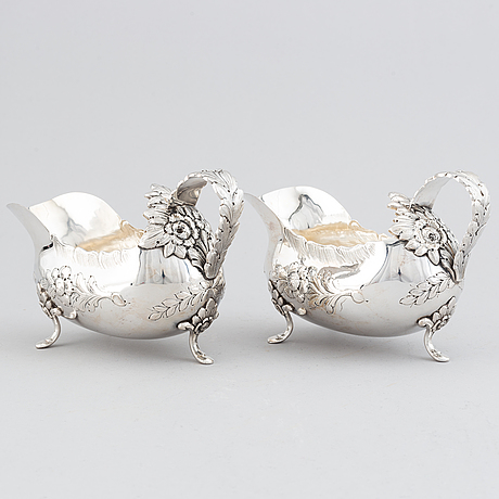 A pair of sterling silver rococo style sauce boats, swedish import marks.