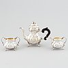 An early 20th century rococo-style parcel gilt and silver three part coffee service.
