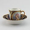 A 19th century sevres  cup and saucer with royal portraits.