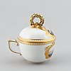 A 19th century meissen miniature lidded porcelain cup decorated with views of mainau.