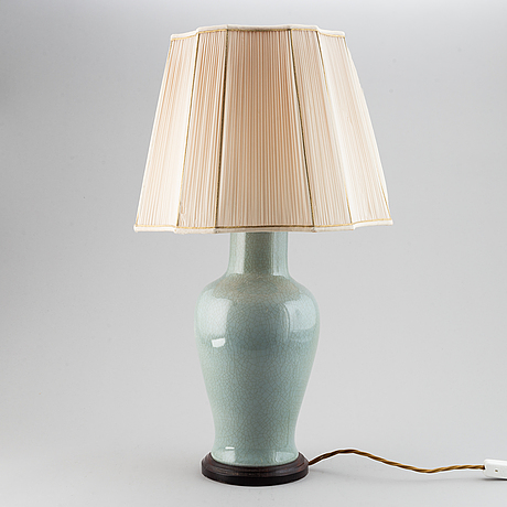 A porcelain table lamp, vaughan, england.