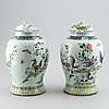 A pair of large chinese famille rose baluster jars with covers, 20th century.