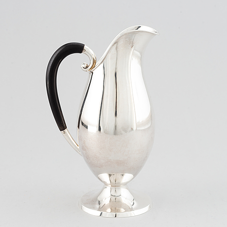 A 20th century silver water jug, import marks, sweden.