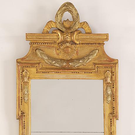 A gustavian mirror by nils meunier dated 1772.