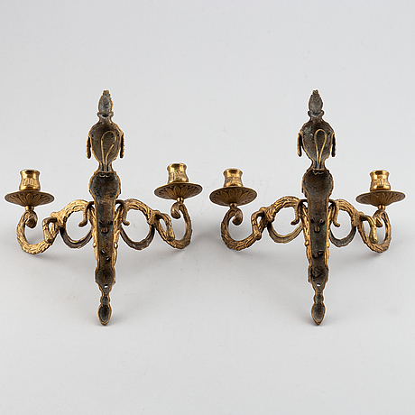 A 20th century pair of louis xvi style wall sconces, for two candles.