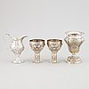 A mixed lot of two beakers, a vase and a jug, baroque style, silver 830, 20th century.