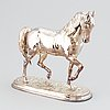 A silver plate sculpture of a stallion by unknown artist.