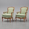 A mid 18th century louis xv pair of bergeres.