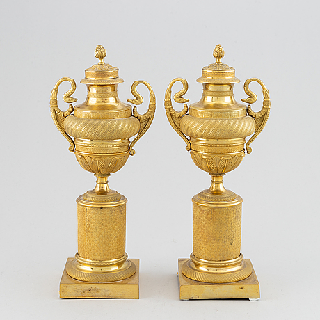 A pair of french empire candlesticks, early 19th century.
