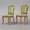 A mid 18th century pair of louis xv chairs.