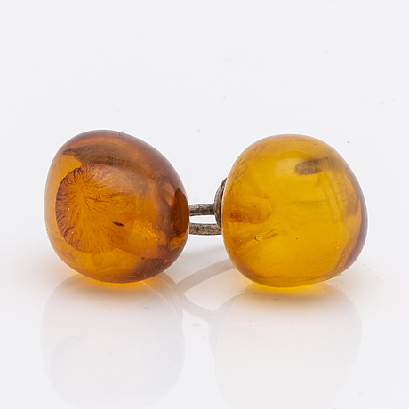 Amber set in silver, pendant, ring and earrings.