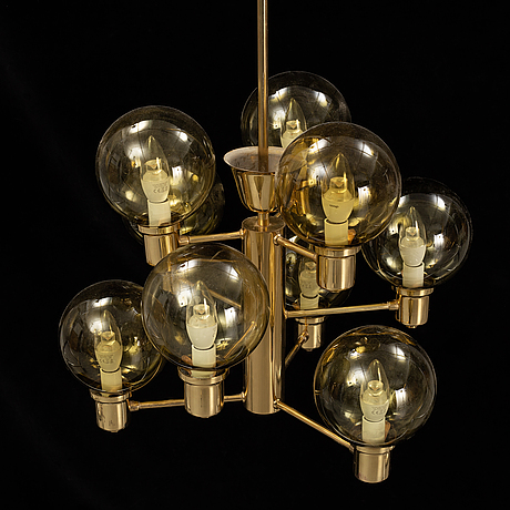 A 1960's brass and glass ceiling light.